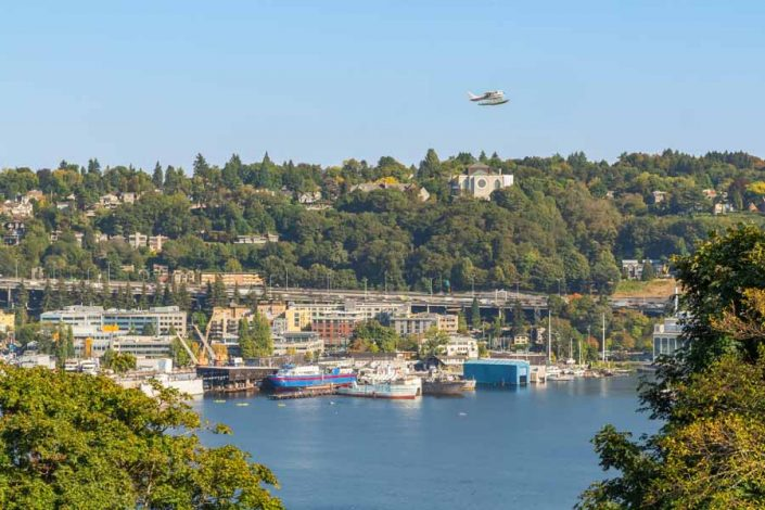 View of Lake Union with seaplane in the air above