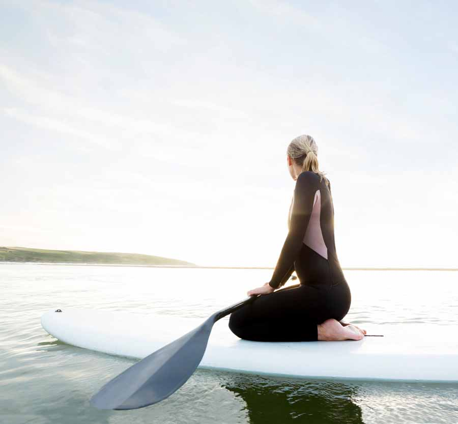 Woman on kneeling on paddleboard