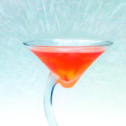 red cocktail with petal background