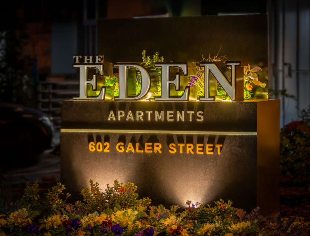 The Eden Apartments sign