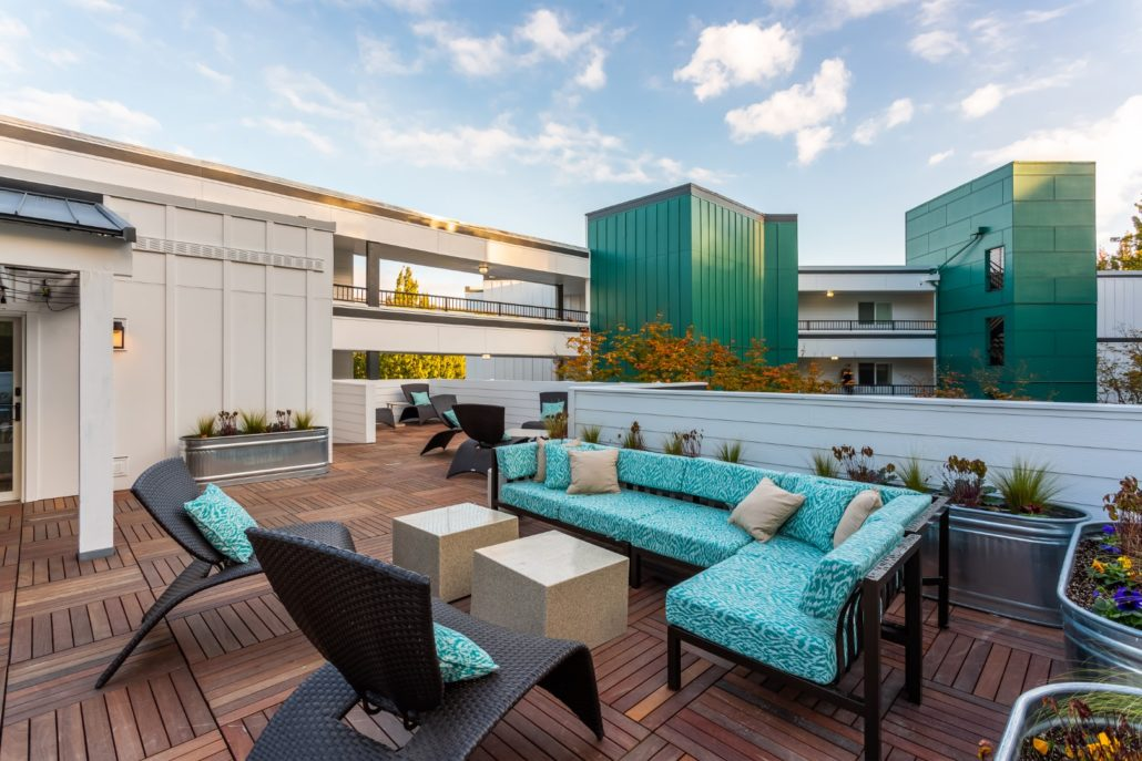 A rooftop patio furnished with comfortable seating.