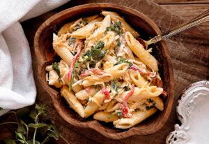 Sicilian Italian pasta traditional in handmade wooden bowl