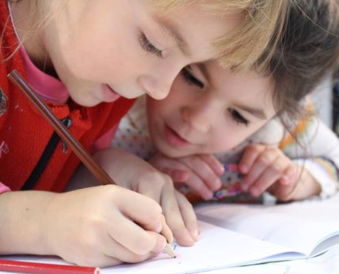 two children doing homework together